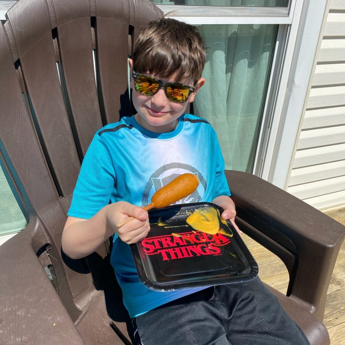 boy eating lunch outside