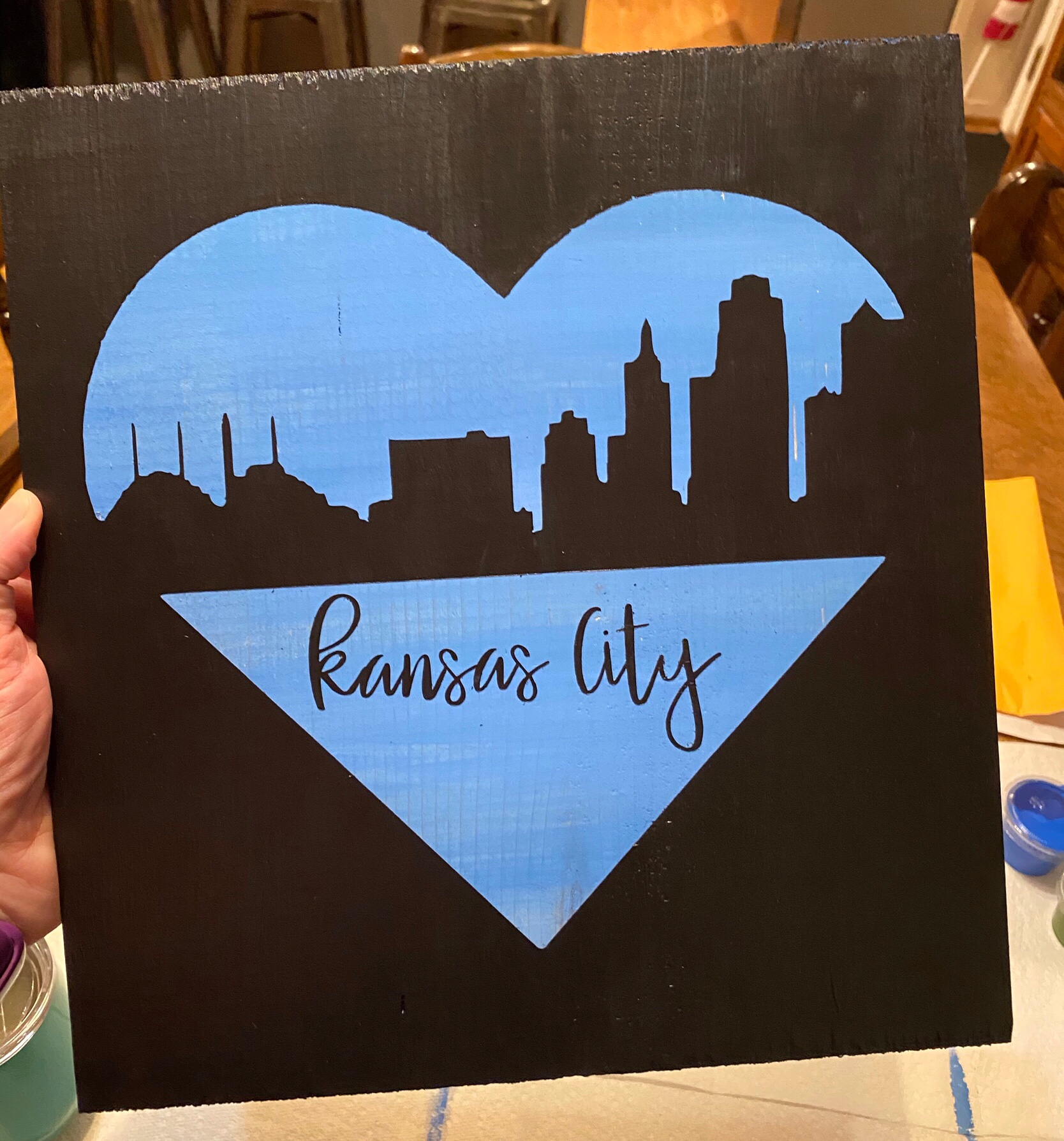 Painting of a heart with Kansas City skyline
